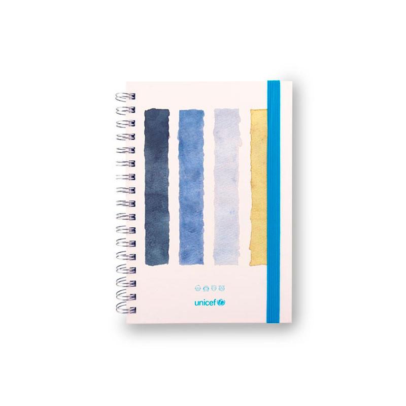 Cuaderno solidario UNICEF, tapa dura a rayas multicolor, Cierre por goma.