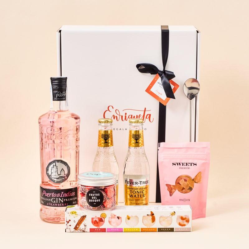 Cesta Gourmet para preparar un gin tonic sorpresa con ginebra Puerto de Indias Strawberry y todo los detalles y complementos